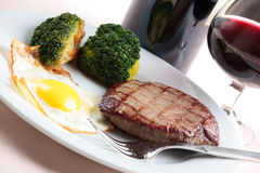 Steak with fried egg Royalty Free Stock Image