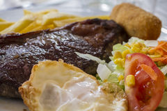 Steak with fried egg and salad Royalty Free Stock Photo