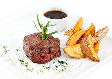 Steak and fried potatoes Stock Photography