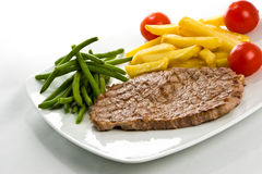 Steak and fries Stock Photos