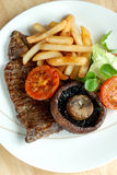 Steak with fries and salad Royalty Free Stock Photo