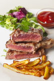 Steak with fries Stock Photos