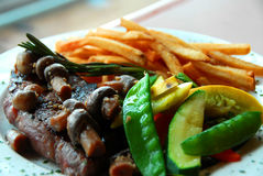 Steak fries vegetables Stock Photo