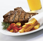 Steak and Fries. On white background Royalty Free Stock Images