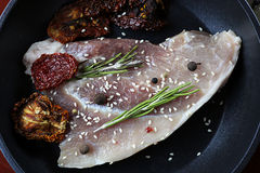 Steak in frying pan Stock Photography