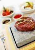 Steak gekocht auf Stein Stockbild