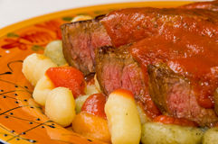 Steak with Gnocchi Royalty Free Stock Photography