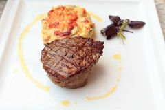 Steak with gratin on a plate Stock Image