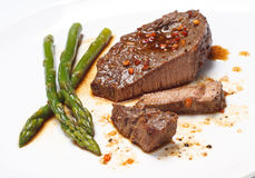 Steak with Green asparagus Royalty Free Stock Image