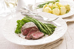 Steak with Green Asparagus royalty free stock photography