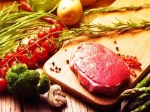 Steak with green asparagus Stock Photos