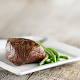 Steak with green beans and copyspace Stock Images