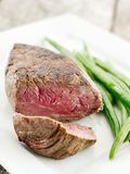 Steak with green beans cut open Stock Photos