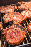 Steak on grill fire-toasted Stock Photos