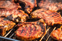 Steak on grill fire-toasted Royalty Free Stock Images
