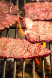 Steak on grill fire-toasted Stock Photography