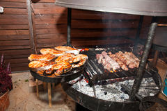 Steak on grill with flames. Stock Photo