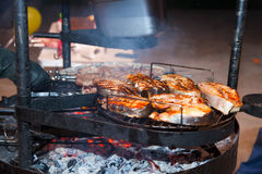 Steak on the grill with flames. Stock Image