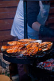 Steak on  grill with flames. Stock Photos