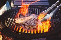 Steak on the grill with flames stock photos
