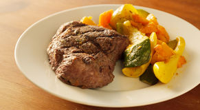 Steak with grill marks and vegetables, Stock Photos