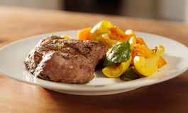 Steak with grill marks and vegetables, Stock Image