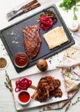Steak grill, ribs, graphite board, still-life from above, food. Steak grill, grill ribs, graphite board, still-life from above, food thyme, pickled beets stock photography