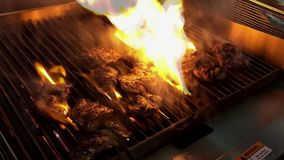Steak On the Grill. Steaks being tenderly grilled in a restaurant kitchen