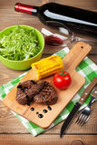Steak with grilled corn, salad and red wine Royalty Free Stock Image