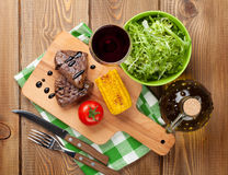 Steak with grilled corn, salad and red wine Royalty Free Stock Photography