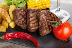 Steak with grilled potato, corn, salad and red wine Stock Image