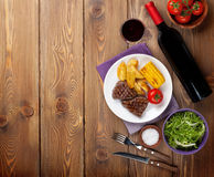 Steak with grilled potato, corn, salad and red wine Royalty Free Stock Photos