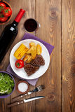 Steak with grilled potato, corn, salad and red wine Royalty Free Stock Images