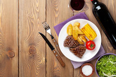 Steak with grilled potato, corn, salad and red wine Stock Photography