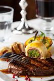 Steak. With grilled potato on a plate Stock Images