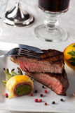 Steak. With grilled potato on a plate Stock Photography