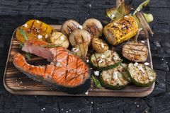 Steak grilled salmon with vegetables Royalty Free Stock Photo