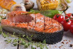 Steak grilled salmon with vegetables Royalty Free Stock Photography
