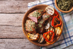 Steak and grilled vegetables with pesto closeup. horizontal top Royalty Free Stock Images