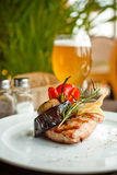 Steak and grilled vegetables Stock Images
