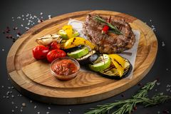Steak with grilled vegetables royalty free stock photo