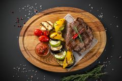 Steak with grilled vegetables royalty free stock image