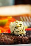 Steak with herb butter. Closeup of a steak with herb butter Royalty Free Stock Photo