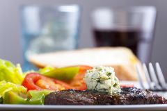 Steak with herb butter. On a plate Royalty Free Stock Image