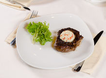Steak with Herbed Butter and Garnish Royalty Free Stock Images