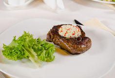 Steak with Herbed Butter and Garnish Stock Photography