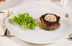 Steak with Herbed Butter and Garnish Royalty Free Stock Photography