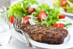 Steak with herbs and vegetables Stock Image