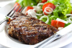 Steak with herbs and vegetables Royalty Free Stock Photo