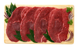 Steak of horse meat. On wooden board Royalty Free Stock Image
